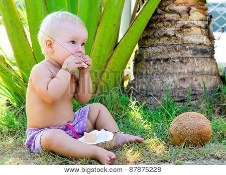 Little child eats coconut