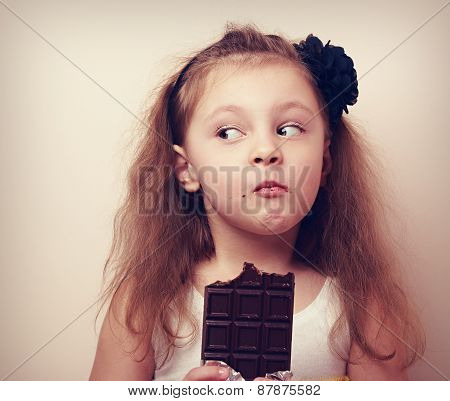 Thinking Humor Kid Face Eating Chocolate. Closeup Vintage