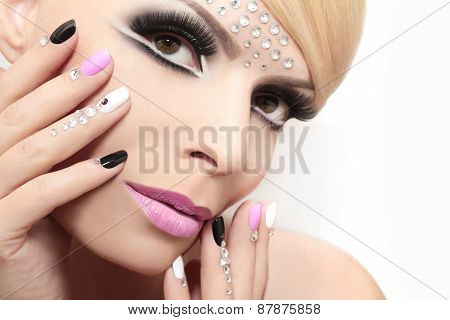 Fashion nails and makeup.