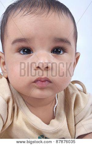 Cute Indian Baby Looking at Camera