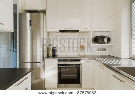 Chrome Fridge In White Kitchen