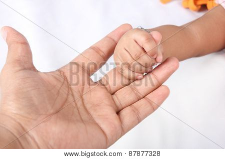 Cute Baby Holding Father's Hand