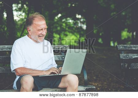 Regular Old Guy Typing On Computer