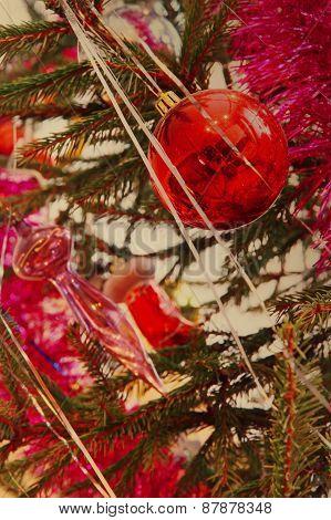 Red Christmas Balls On A Pine Branch Taken Closeup.