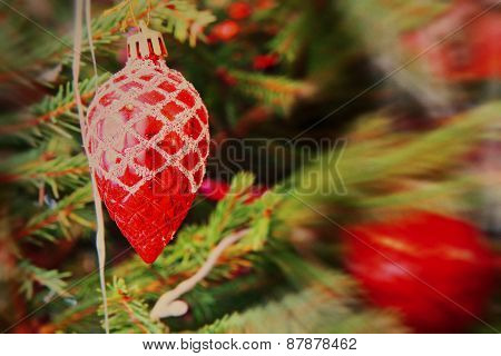 Red Christmas Balls On Spruce Branch With Soft Bokeh.