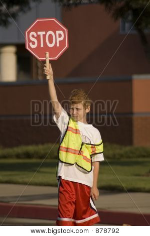 Crossing Guard On Duty At Local Grammer School