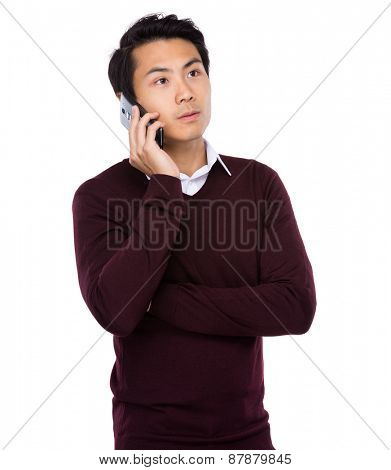 Asian businessman talking on mobile cell phone