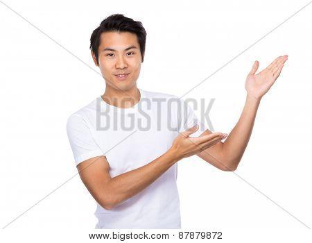 Asian man present something