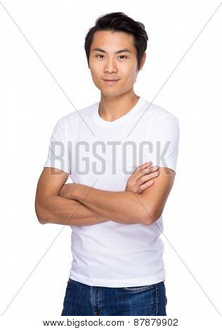 Young man standing with arms crossed