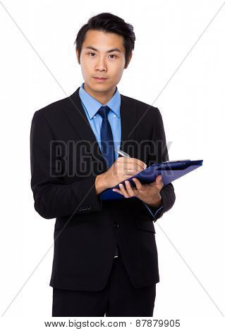 Happy business man with financial report