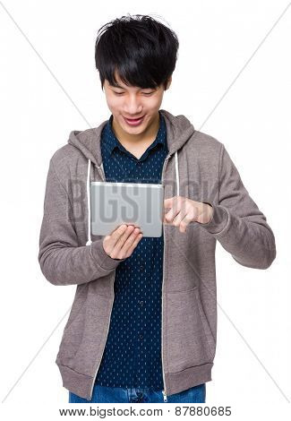 Asian man standing with tablet computer