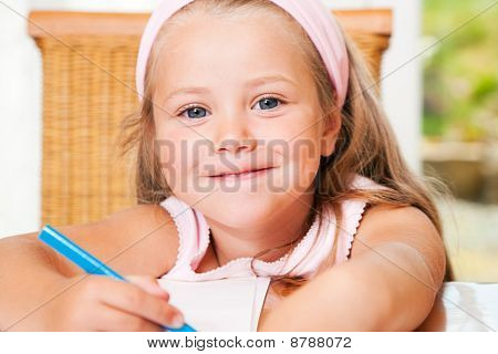 Child drawing something at home