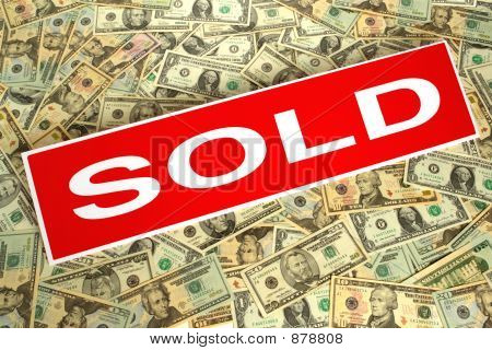 Sold Sign over Dollar Background