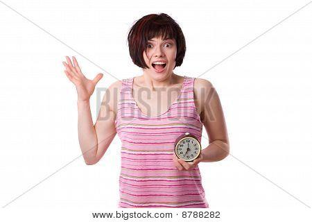 Sleepy woman is holding alarm clock
