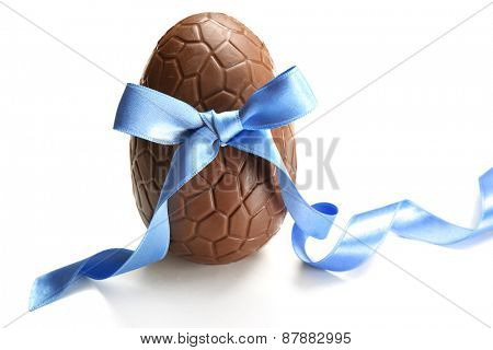 Chocolate Easter egg with color ribbon bow isolated on white