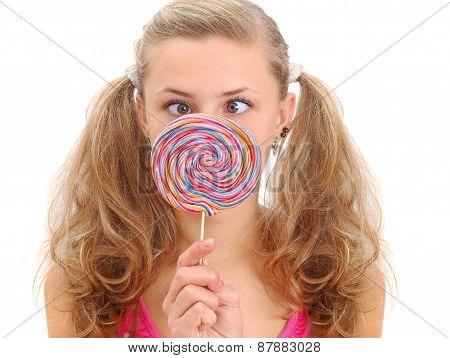 Pretty Teenage Girl With A Lollipop