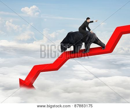 Businessman Riding Bear On Arrow Downward Trend Line With Sky