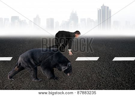 Businessman And Bear Are Ready To Race On Asphalt Road