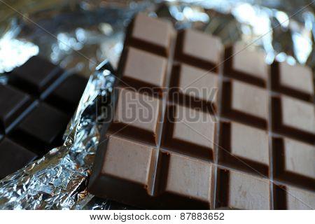 Set of chocolate on foil, closeup