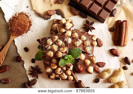 Still life with set of chocolate on table, top view