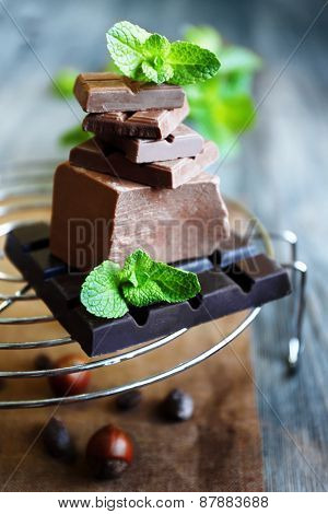 Set of spicy chocolate on metal stand, closeup