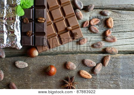 Delicious chocolate with spices on wooden table, closeup
