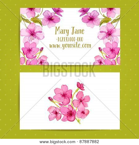 Business card template with watercolor flowers of cherry blossom. Vector layout.