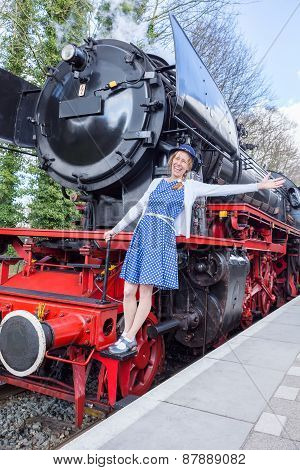 European woman expressing happiness for freedom and peace on steam train