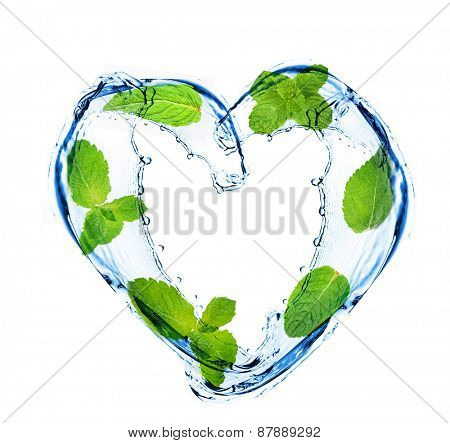 Green leaves and water splashing shaped as heart frame, isolated on white