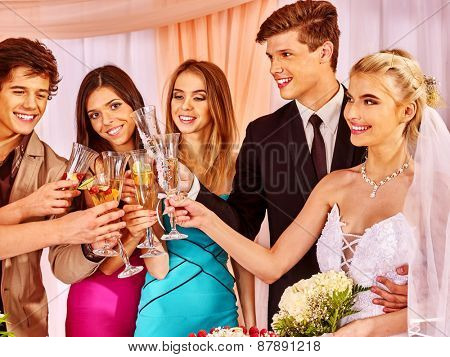 Hand holding wedding glass with champagne.