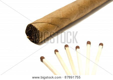 Single Cigar And Few Matches