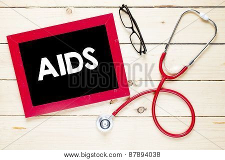 Blackboard with AIDS and stethoscope