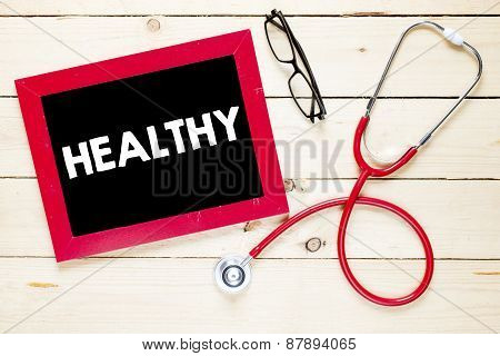 Blackboard with healthy and stethoscope