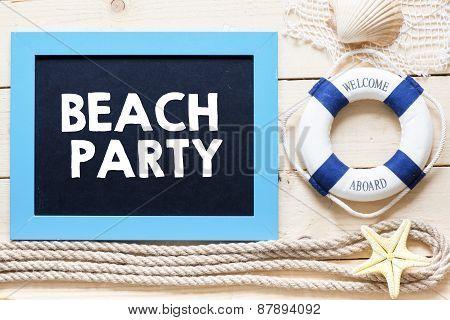 Beach party written on blackboard