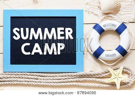 Summer camp written on blackboard