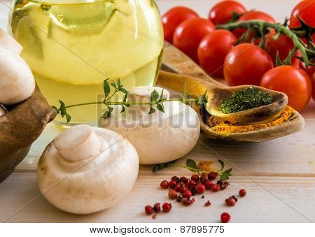 food ingredients for cooking vegetarian food on a wooden background