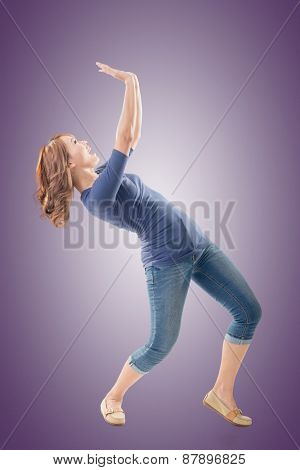 Full length portrait of Asian woman under stress, isolated on studio background.