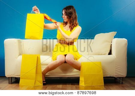 Woman With Shopping Bags On Couch