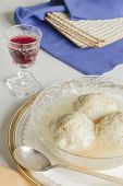 stock photo of passover  - Traditional passover matzoh ball soup with unleavened bread and wine - JPG