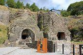 image of ironworker  - ruined kiln at Blaenavon Ironworks in Wales - JPG