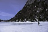 picture of avalanche  - Man trecking across Avalanche Lake in the Adirondack mountains New York - JPG