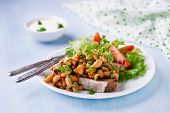 stock photo of stew  - Stewed white beans in tomato sauce on toasted bread with salad selective focus - JPG