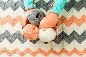 foto of knitting  - rolls of soft knitting yarn knitting female hands on white background  - JPG
