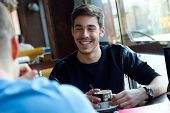 pic of internet-cafe  - Portrait of group of friends using mobile phone in cafe - JPG