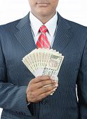 picture of indian currency  - Portrait of Indian business man holding indian money - JPG