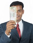 stock photo of indian currency  - Portrait of Indian business man holding indian money - JPG