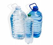 foto of plastic bottle  - Two large plastic bottle with handles and one little bottle with drinking water on a light background - JPG