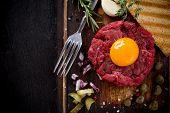 stock photo of tartar  - fresh beef tartar with egg - JPG