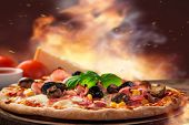 picture of wooden table  - Delicious italian pizza served on wooden table - JPG