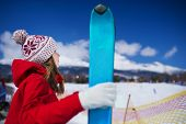 pic of nordic skiing  - Young woman skiing outside in sunny winter mountains - JPG